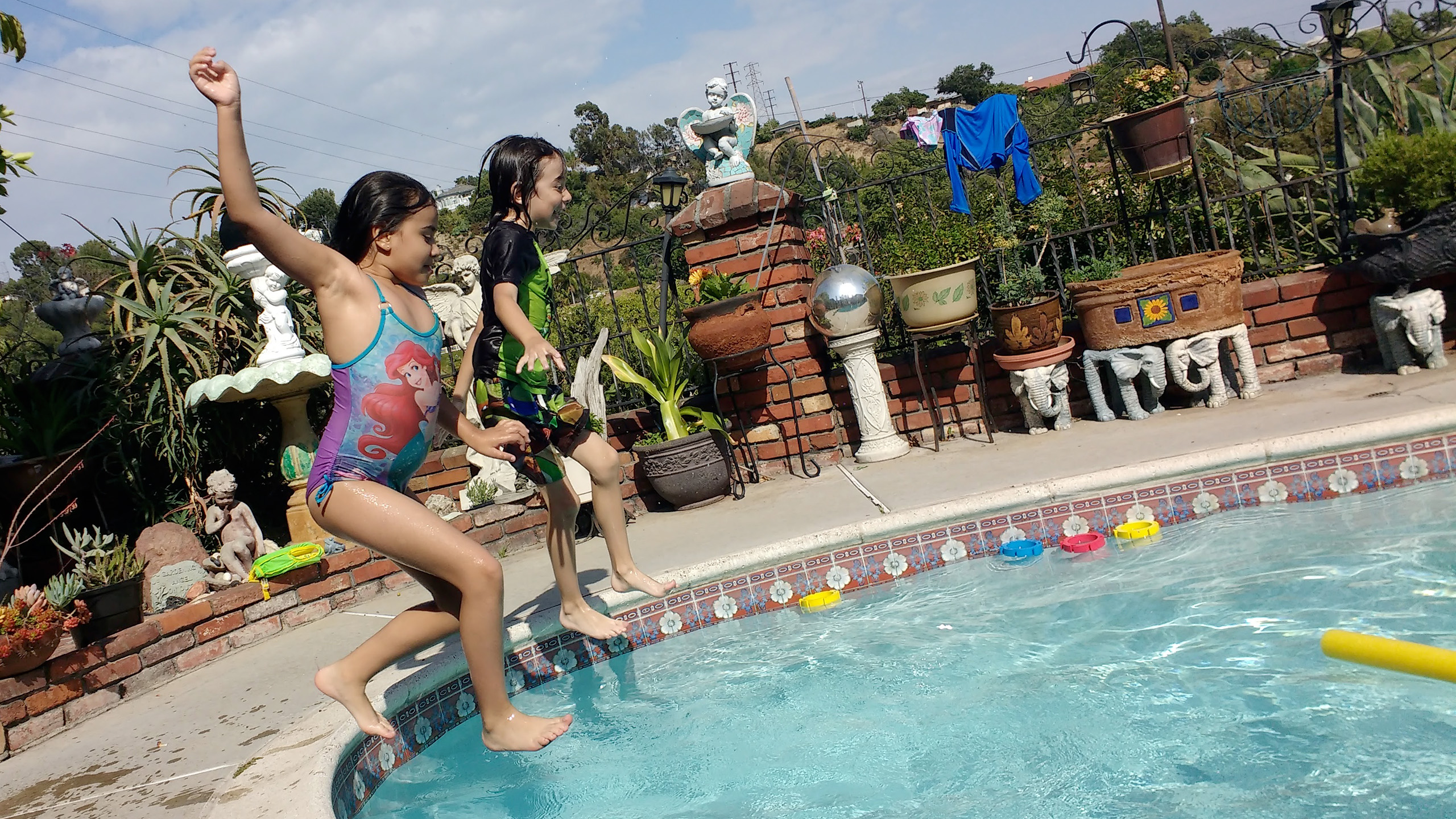 Chanielle & Dominic diving to adventure at a pool party at mom's!