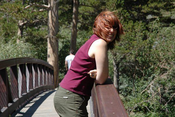 Leee Hockenberry leaning on a bridge railing