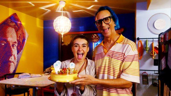 Marta Troya & Glenn Zucman smiling and holding a cake