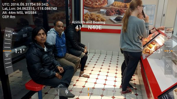 Dioptra GPS / XYZ Compass image of people ordering at a Dominoes Pizza window