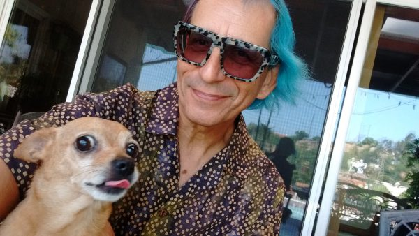 Tiki the chihuahua and Glenn the human sit on the patio in Monterey Park, Ca