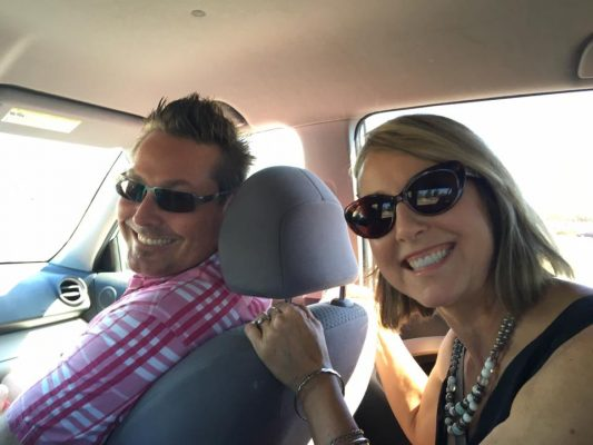 Photo of Daniel & Denise inside a car